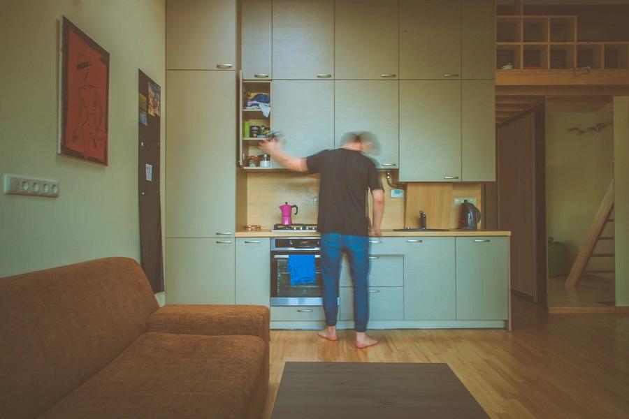blurred man in his kitchen
