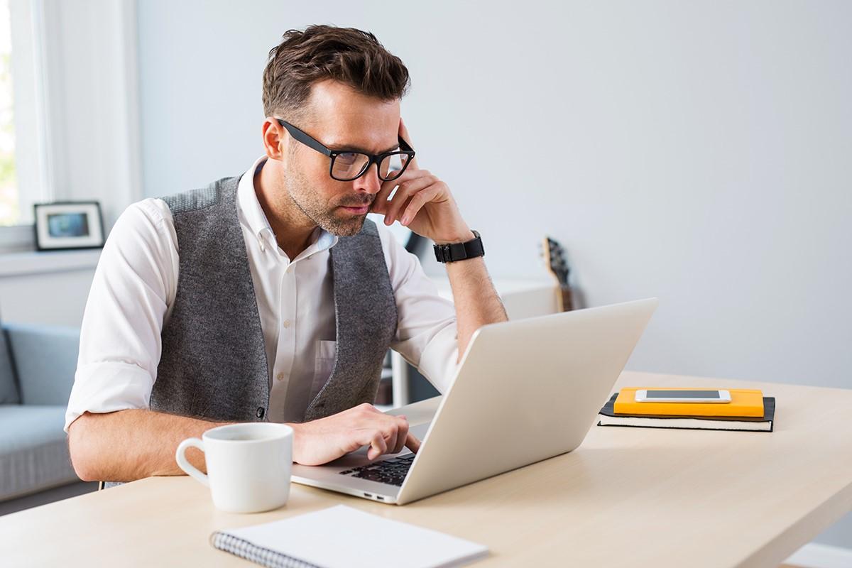 man-think-looking-at-laptop