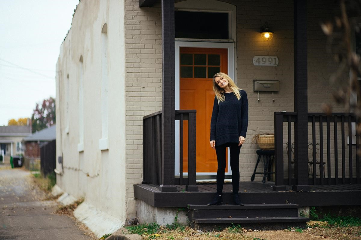 woman-in-front-of-home