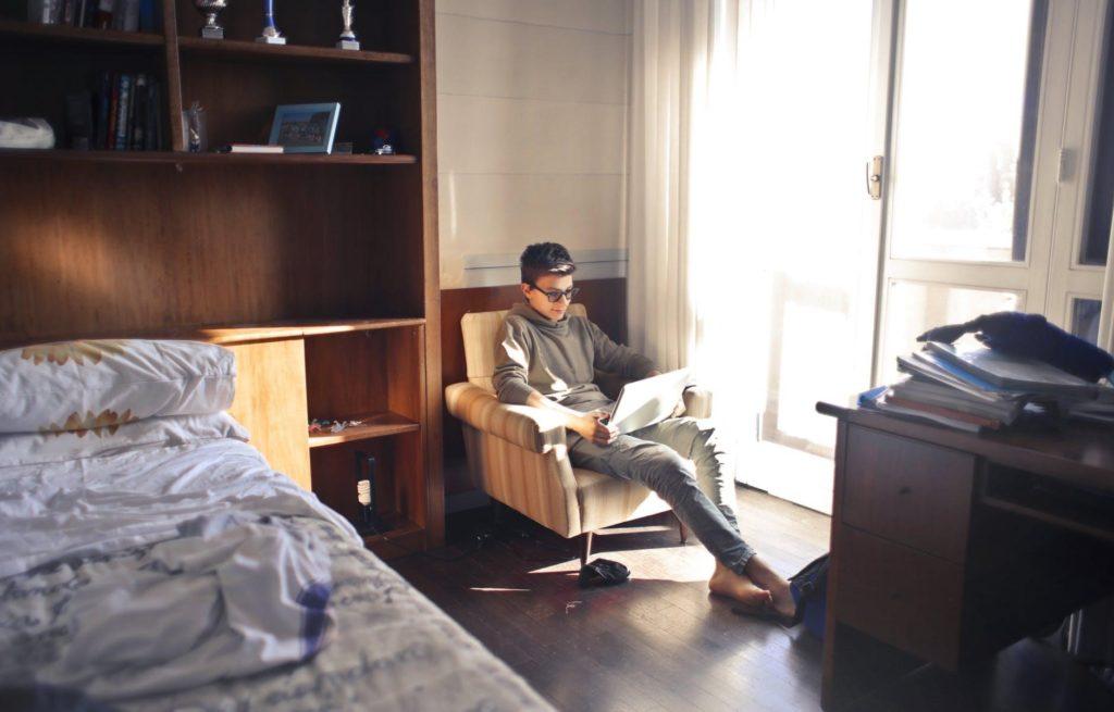 man-sitting-sofa-bedroom