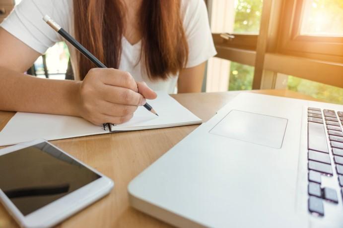 woman-writing-laptop-homework