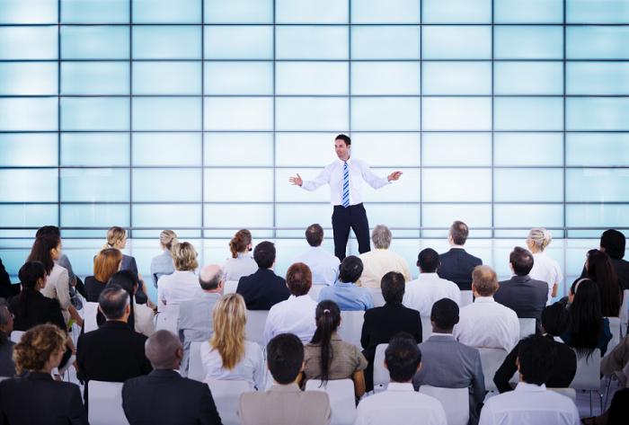 Business Man giving presentation e1437692582539