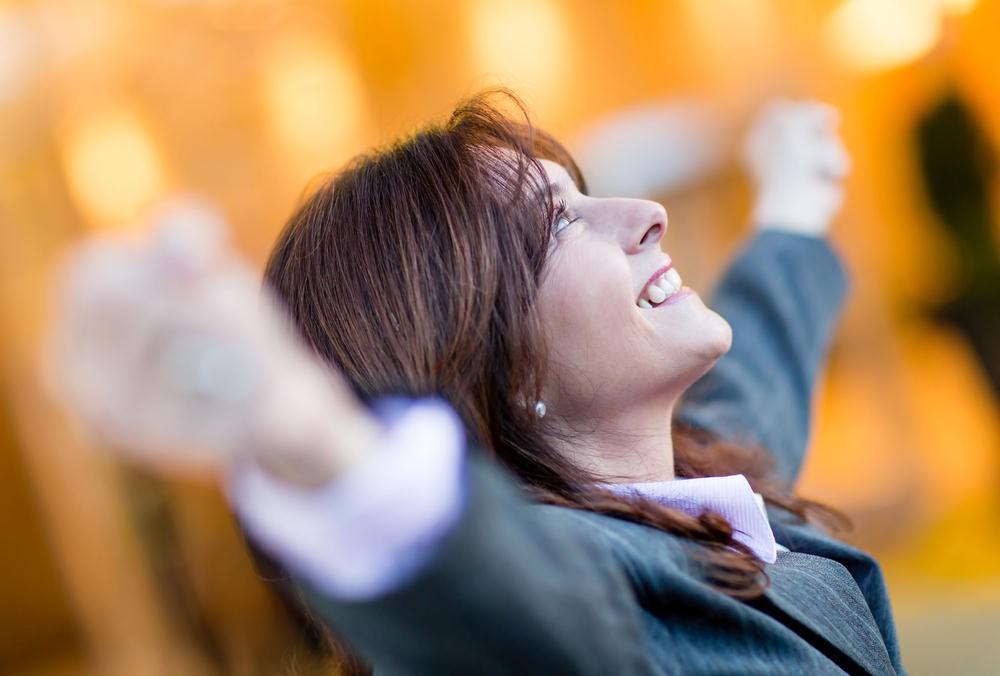 woman-raising-hands-in-achievement