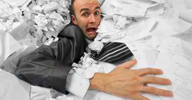 adversity-man-stuck-in-pile-of-papers