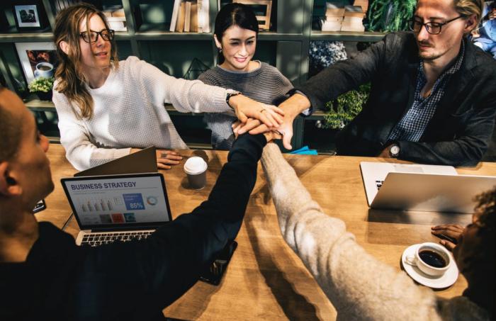 team-meeting-hands-in