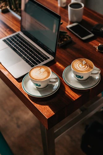 two-coffees-cappuccino-laptop