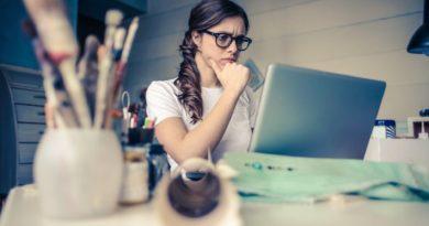 woman looking at laptop-laptop-thinking-choosing