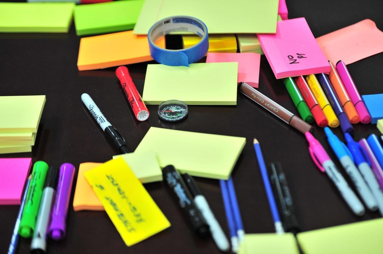 photo-of-stick-notes-and-colored-pens
