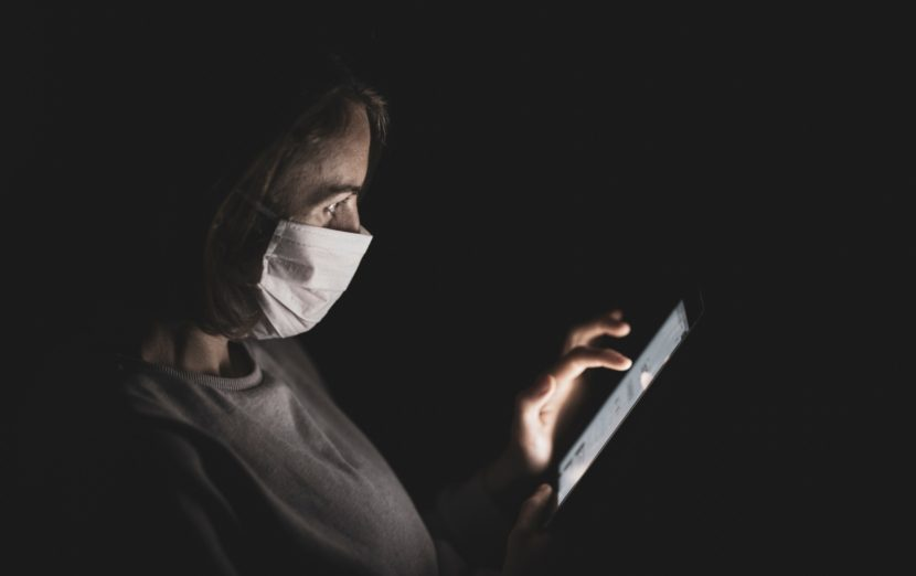 woman-reading-tablet-woman-mask