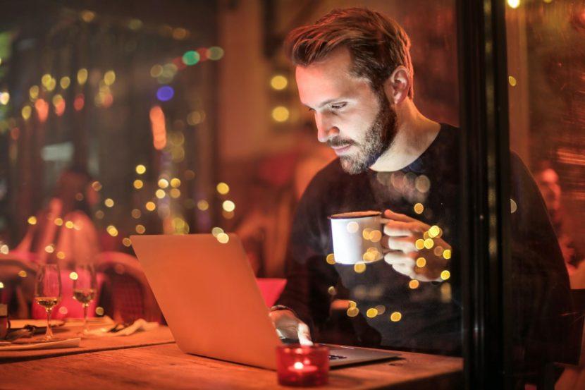 online-working-studying-laptop-man on laptop