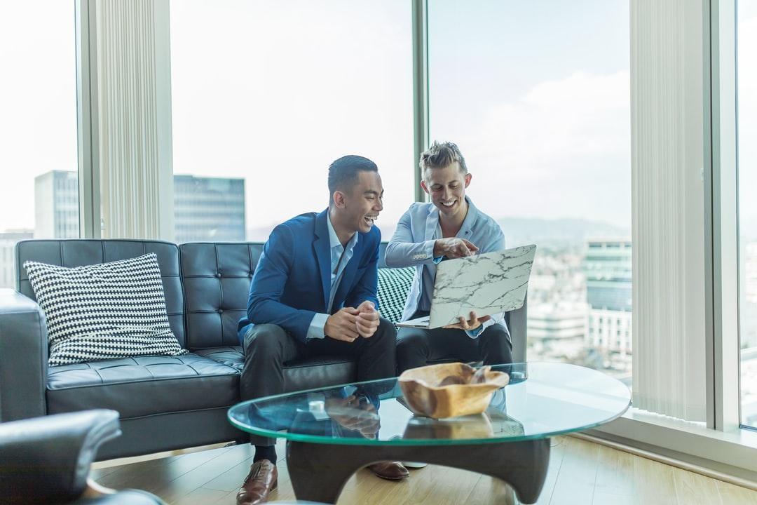 business men-laptop-guys-working-laughing-agreeing-meeting