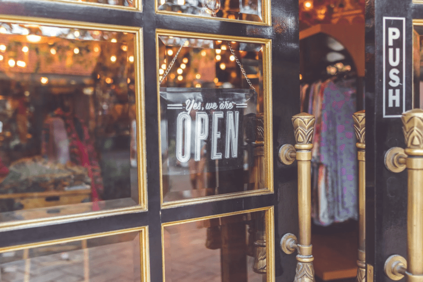 open sign-window storefront-commerce-store