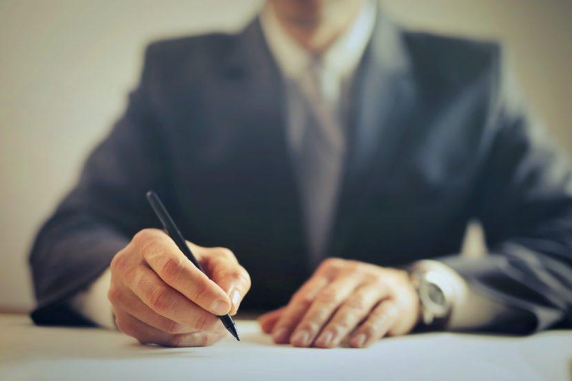 man writing-entrepreneur-business man