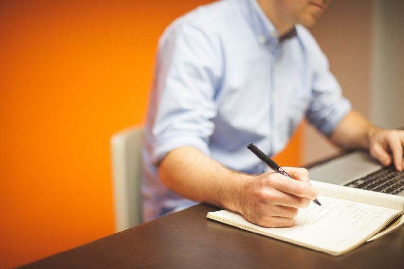 man taking notes-man writing-working-note